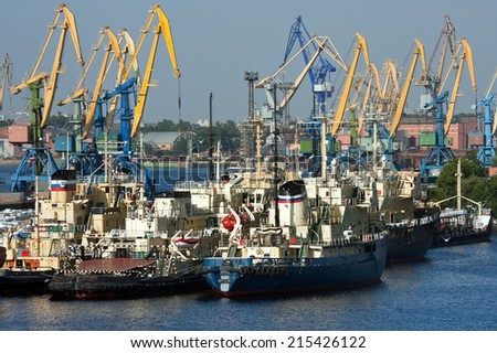View of sea port with ships and cranes - stock photo