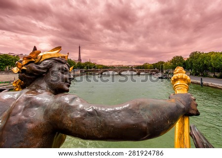 View of Seine river and Eiffel Tower on background under cloudy sky from Alexander the III bridge in Paris, France. - stock photo