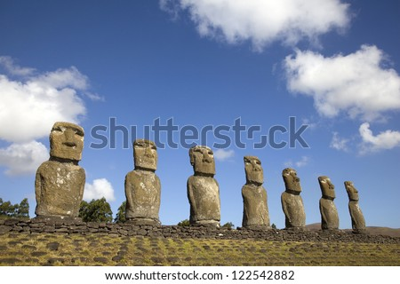 View of seven Ahu Akivi Moai, which are the only Moai to face the sea, Rapa Nui, Easter Island, Chile. - stock photo