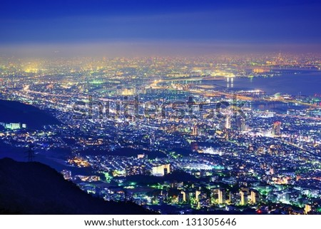 """View of several Japanese cities in the Kansai region from Mt. Maya. The view is designated a """"Ten Million Dollar Night View."""" - stock photo"""