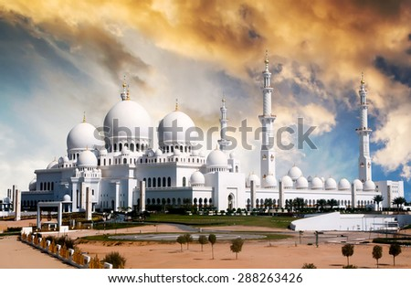 view of Sheikh Zayed mosque in Abu Dhabi at sunset - stock photo