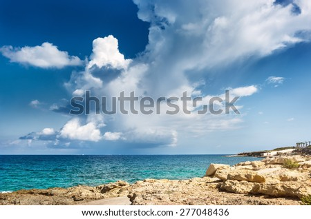 View of shore with sandstone and scenic clouds on the sea. Malta - stock photo