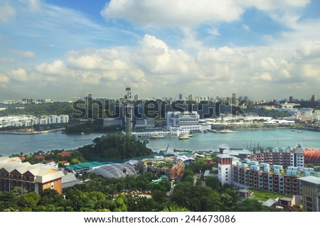 View of Singapore from the height of Heaven tower Sentosa island Sentosa island is a wonderful island entertainment in Singapore. The highest observation deck in the Middle is the Celestial tower. - stock photo