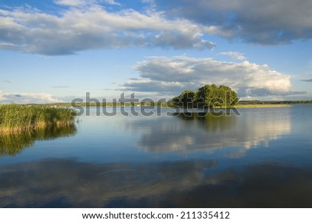 View of small island on the lake in Masuria district, Poland