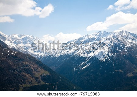 View of snowy mountain peaks - stock photo