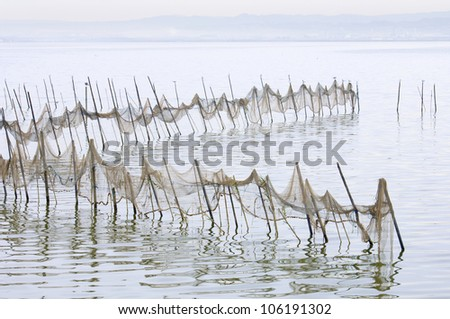 view of some fishing nets on standing water in La Albufera, Valencia, Spain - stock photo