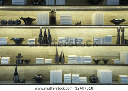 View of some shelves filled with books and decoration items - stock photo