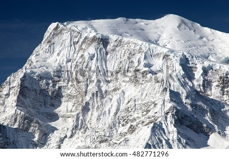 View of south rock face of mount Annapurna 3 III, Annapurna range, Annapurna circuit trekking trail, Nepal