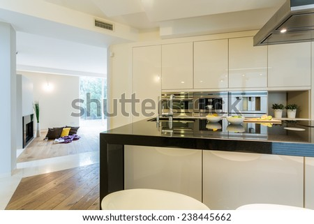 View of spacious kitchen in modern apartment - stock photo