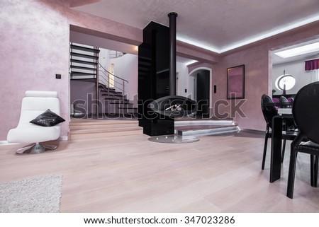 View of spacious modern interior with elegant staircase - stock photo