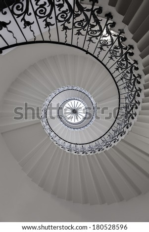 View of spiral staircase from the ground looking up - stock photo