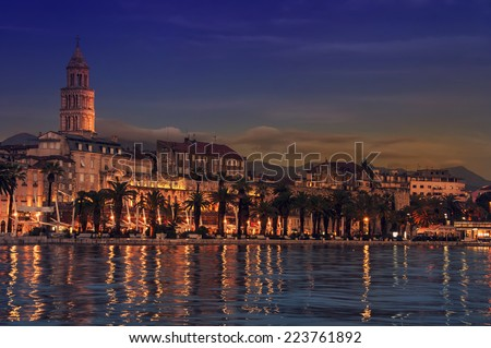 View of Split is the second-largest city of Croatia at night. Shore of the Adriatic Sea and famous Palace of the Emperor Diocletian - archaeological gem and a must-see for everyone - stock photo