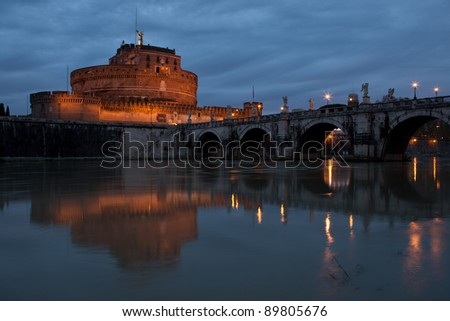 View of St. Angel Castle from Tiber river in Rome at dawn - stock photo