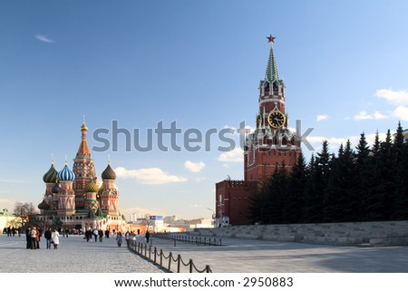 View of St. Basil the Blessed Cathedral and Kremlin's Spasskaya tower. Red Square, Moscow. Russia.