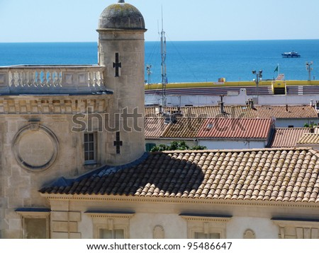 View of St. Maries de la Mer from the roof of the church of Notre Dame de la Mer C - stock photo