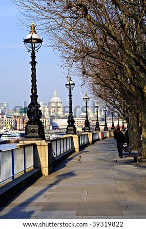 View of St. Paul's Cathedral from South Bank of Thames river in London - stock photo