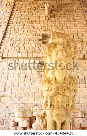 View of Stela M with the Hieroglyphic Stairway in background at the ancient Mayan ruins of Copan. Honduras, Central America. - stock photo
