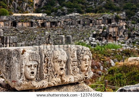 View of stone stage masks in front of an ancient amphitheater in Myra Turkey - stock photo