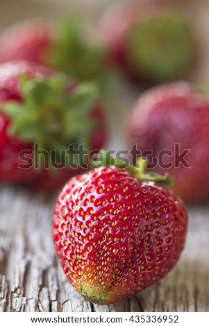 View of strawberries background of old natural wood