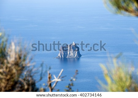 view of Strombolicchio island from the volcano - stock photo