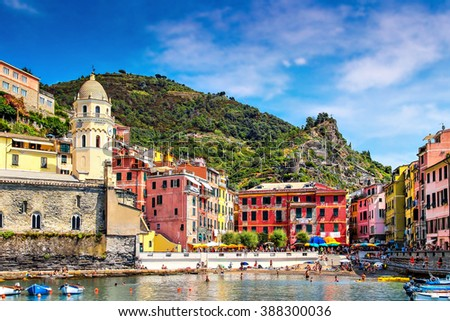 View of summer Vernazza village with many tourists, Cinque Terre, Italy. - stock photo