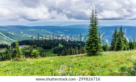 View of Sun Peaks village and valley from Tod Mountain in the Sushwap Highlands and part of the Sun Peaks ski resort in central British Columbia - stock photo