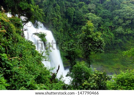 View of Tad Yueng waterfall with during the rainy season in Champasak province, Southern Laos - stock photo