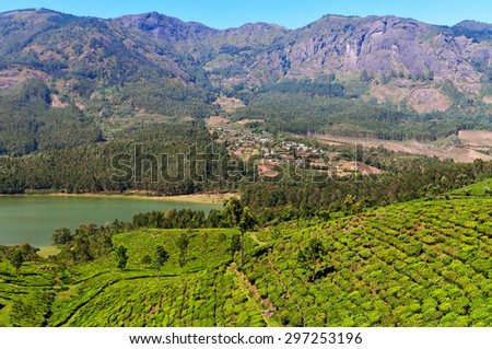 View of tea plantation valley and Madupetty Dam in Munnar. Kerala. India - stock photo
