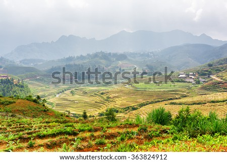 View of terraced rice fields at highlands of Sapa District, Lao Cai Province, Vietnam. Sa Pa is a popular tourist destination of Asia.