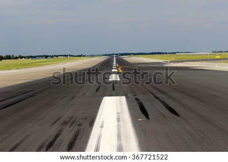 View of the airport runway from its center - stock photo