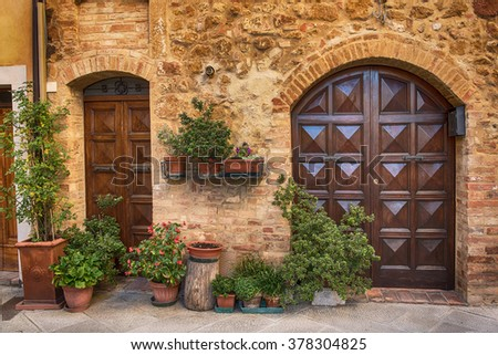 View of the ancient old european city. Street of Pienza Italy with wooden doors & View Ancient Old European City Street Stock Photo 378304825 ...