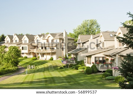 View of the back yards of multiple family residences in a suburban neighborhood.
