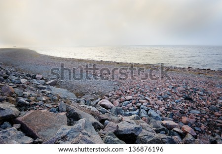 View of The Baltic sea shoreline in the fog - stock photo