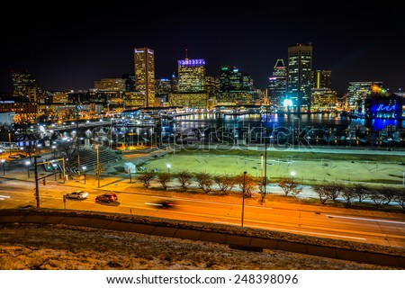 View of the Baltimore skyline and Inner Harbor at night, seen from Federal Hill, Baltimore, Maryland. - stock photo
