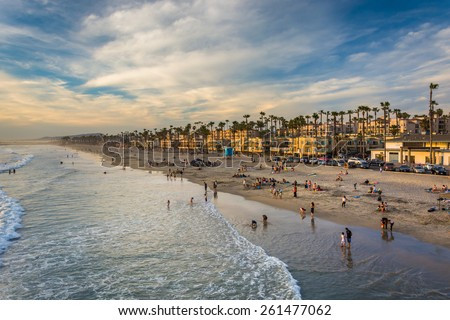 View of the beach from the pier in Oceanside, California. - stock photo