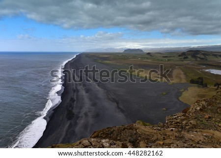View of the black sand beach from the cliff of Dyrholaeyjarviti, Iceland - stock photo