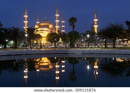 View of the Blue mosque and its reflection in the fountain at night, Istanbul - stock photo
