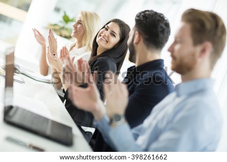 View of the business people clapping in the office