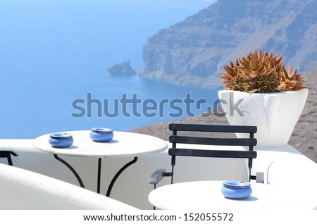 View of the Caldera and passenger ferries from the Greek island of Santorini - stock photo