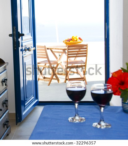view of the caldera in mediterranean sea in oia ia santorini from a traditional cave house villa rental - stock photo