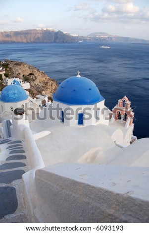 View of the caldera in Santorini with blue church dome