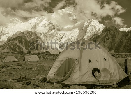 View of the camp of climbers on Khumbu glacier near near Gorak Shep village with Everest in the background - Nepal, Himalayas (stylized retro) - stock photo
