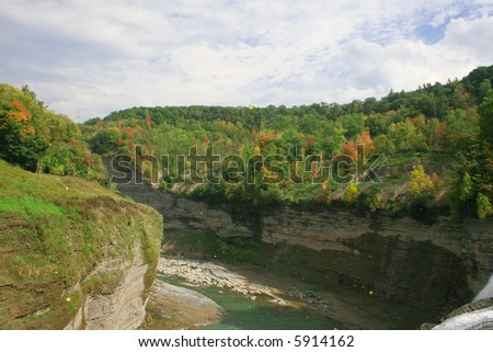 "View of the canyon at Letchworth State Park, upstate New York, in the Fall. It is called the ""Grand Canyon"" of the east. Fall foliage. - stock photo"