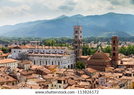 View of the Cathedral of St Martin in Lucca, Italy. Seen from the �´Torre delle ore�´ - stock photo