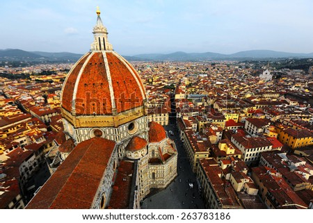 View of the Cathedral Santa Maria del Fiore in Florence, Italy ~ Florence's cathedral stands tall over the city with its magnificent Renaissance dome designed by Filippo Brunelleschi.  - stock photo