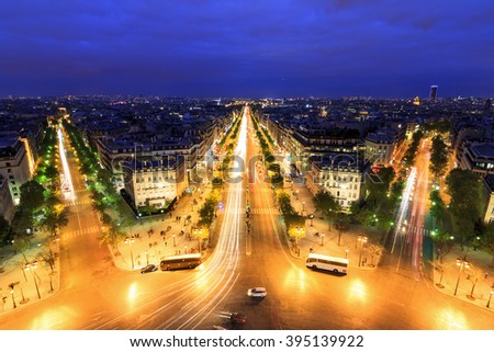 View of the Champs-Elysees seen from the Arc de Triomphe at twilight in Paris, France - stock photo