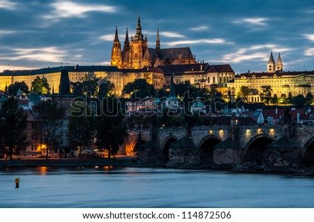 View of the Charles Bridge and Castle in Prague in the evening - stock photo