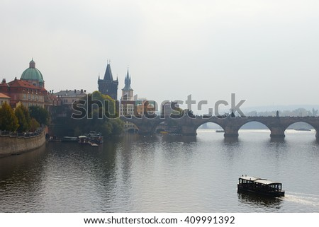 View of the Charles Bridge in Prague foggy morning - stock photo