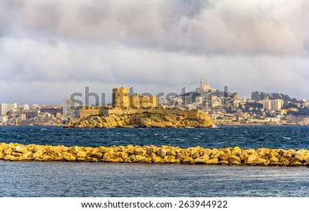 View of the Chateau d'If and the basilica Notre-Dame de la Garde - Marseille - stock photo