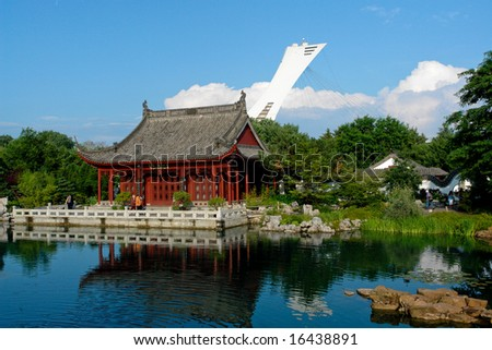 View of the Chinese Garden in Montreal with the olympic stadium in the background - stock photo